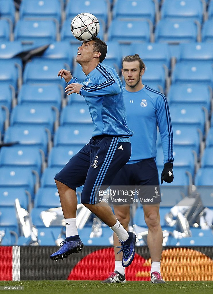Cristiano Ronaldo of Real Madrid plays with the ball during a training session ahead of the UEFA Champions League Semi Final match between Manchester City FC and Real Madrid at the Etihad Stadium on April 25, 2016 in Manchester, United Kingdom.