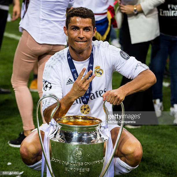 Cristiano Ronaldo of Real Madrid poses for a photo with the Champions League trophy during the UEFA Champions League Final between Real Madrid and...