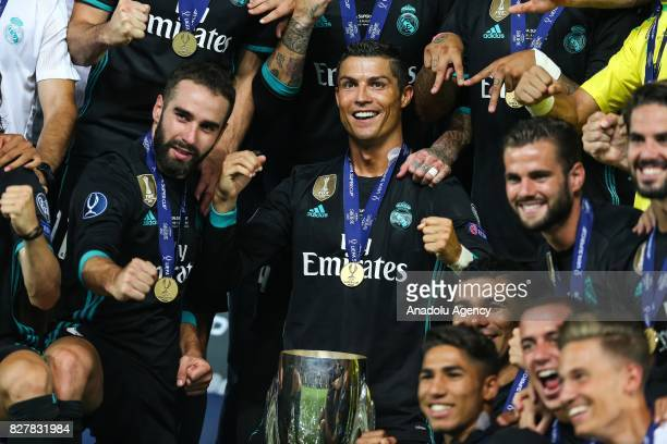 Cristiano Ronaldo of Real Madrid poses for a photo with the trophy after Real Madrid wins the UEFA Super Cup title in the final match against...