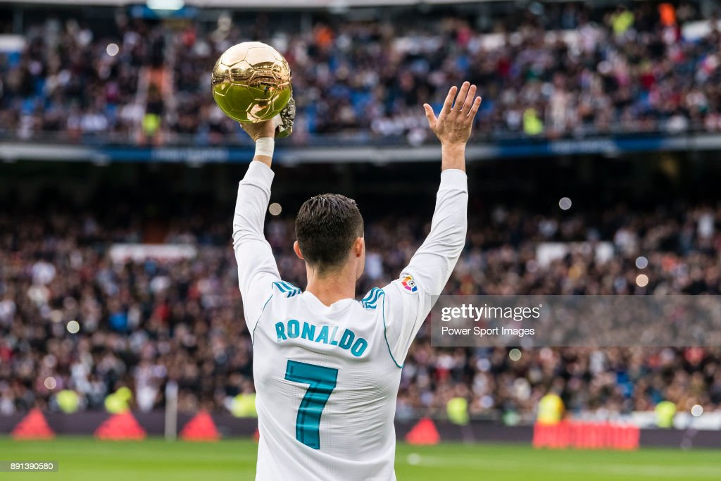 Cristiano Ronaldo of Real Madrid poses for photos with his FIFA Ballon Dor Trophies during the La Liga 2017-18 match between Real Madrid and Sevilla FC at Santiago Bernabeu Stadium on 09 December 2017 in Madrid, Spain.