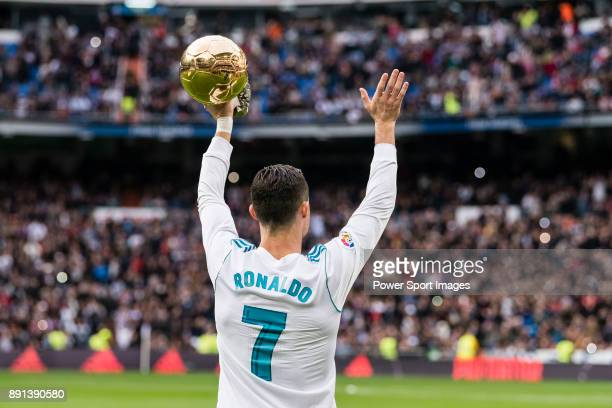Cristiano Ronaldo of Real Madrid poses for photos with his FIFA Ballon Dor Trophies during the La Liga 2017-18 match between Real Madrid and Sevilla...