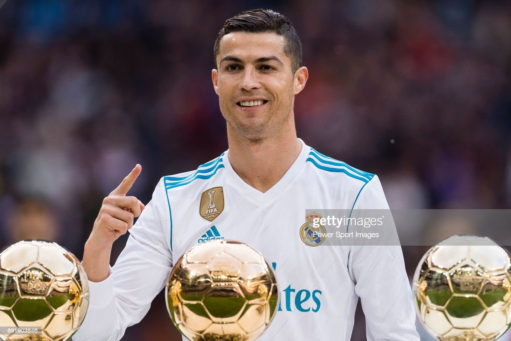 Cristiano Ronaldo of Real Madrid poses for photos with his FIFA Ballon Dor Trophies prior to the La Liga 2017-18 match between Real Madrid and Sevilla FC at Santiago Bernabeu Stadium on 09 December 2017 in Madrid, Spain.