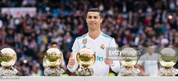 Cristiano Ronaldo of Real Madrid poses for photos with his FIFA Ballon Dor Trophies prior to the La Liga 201718 match between Real Madrid and Sevilla...