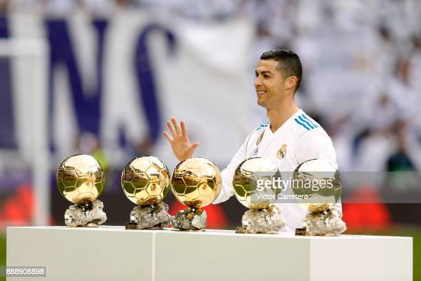 Cristiano Ronaldo of Real Madrid poses with his five Ballon d'Or trophies before the La Liga match between Real Madrid and Sevilla at Estadio...