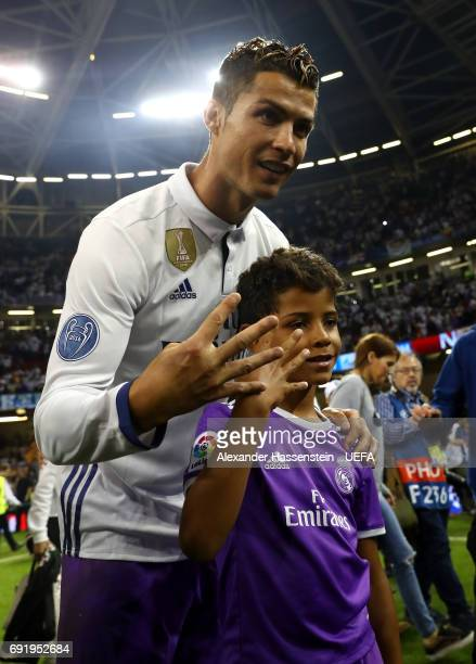 Cristiano Ronaldo of Real Madrid poses with his son after the UEFA Champions League Final between Juventus and Real Madrid at National Stadium of...