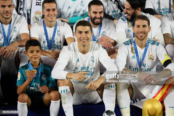 Cristiano Ronaldo of Real Madrid poses with his son Cristiano Ronaldo Jnr and teammates at the end of the FIFA Club World Cup UAE 2017 final match...