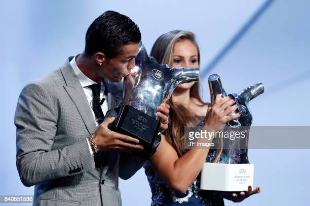 Cristiano Ronaldo of Real Madrid poses with his trophy of Best Men's player in Europe during the UEFA Champions League Group stage draw ceremony at...
