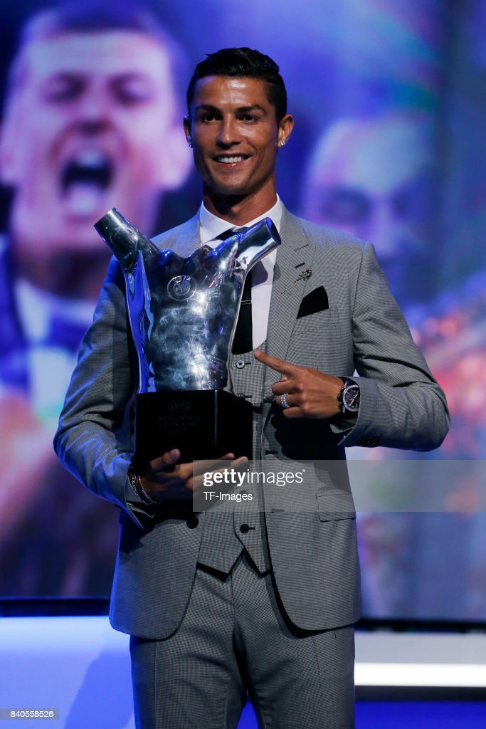 Cristiano Ronaldo of Real Madrid poses with his trophy of Best Men's player in Europe during the UEFA Champions League Group stage draw ceremony, at the Grimaldi Forum, Monte Carlo in Monaco, on August 24, 2017.