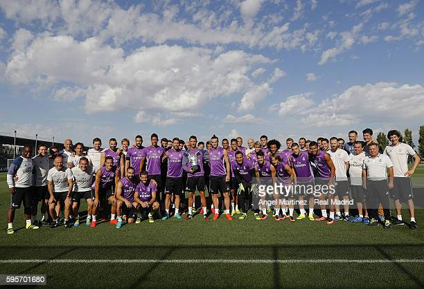 Cristiano Ronaldo of Real Madrid poses with team mates before a training session a day after winning the UEFA Best Player in Europe at Valdebebas...