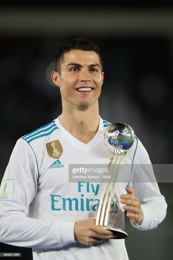 Cristiano Ronaldo of Real Madrid poses with the adidas Golden Ball trophy at the end of the FIFA Club World Cup UAE 2017 final match between Gremio and Real Madrid CF at Zayed Sports City Stadium on December 16, 2017 in Abu Dhabi, United Arab Emirates.