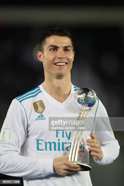 Cristiano Ronaldo of Real Madrid poses with the adidas Golden Ball trophy at the end of the FIFA Club World Cup UAE 2017 final match between Gremio...
