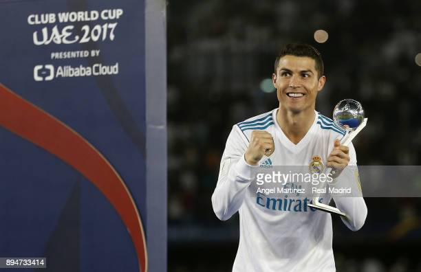 Cristiano Ronaldo of Real Madrid poses with the adidas Golden Ball trophy at the end of the FIFA Club World Cup UAE 2017 Final match between Real...