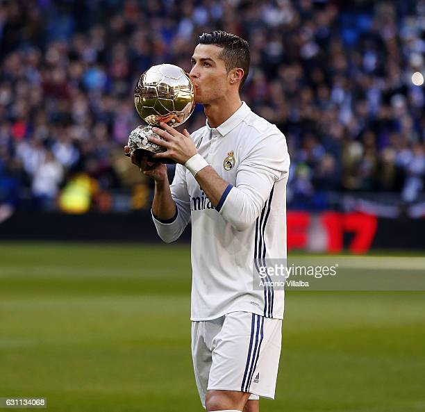 Cristiano Ronaldo of Real Madrid poses with the Ballon d'Or France Football trophy before the La Liga match between Real Madrid and Granada CF on...