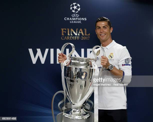 Cristiano Ronaldo of Real Madrid poses with the Champions League trophy after the UEFA Champions League Final match between Juventus and Real Madrid...