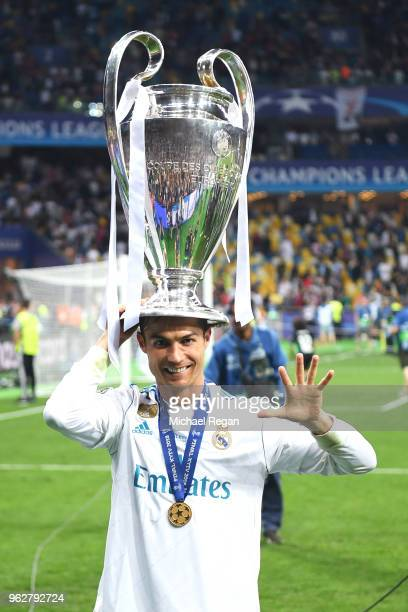 Cristiano Ronaldo of Real Madrid poses with the UEFA Champions League trophy following the UEFA Champions League Final between Real Madrid and...