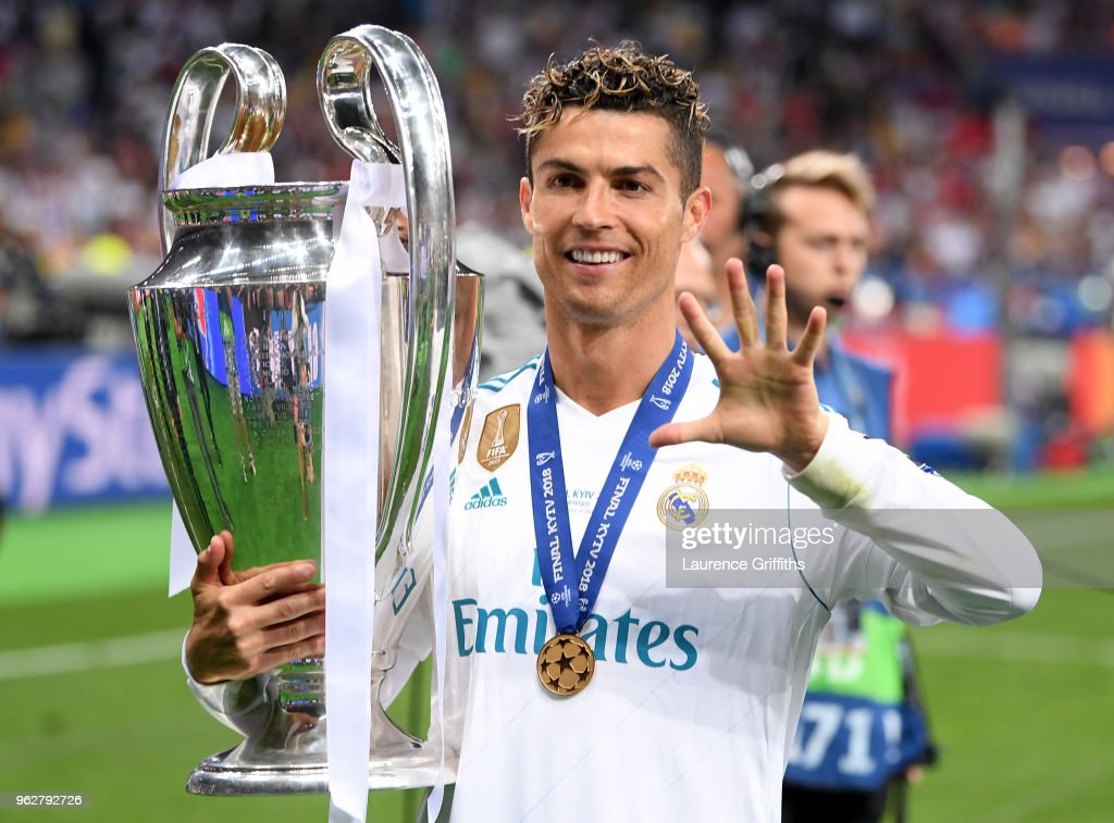 Cristiano Ronaldo of Real Madrid poses with the UEFA Champions League trophy following the UEFA Champions League Final between Real Madrid and Liverpool at NSC Olimpiyskiy Stadium on May 26, 2018 in Kiev, Ukraine.