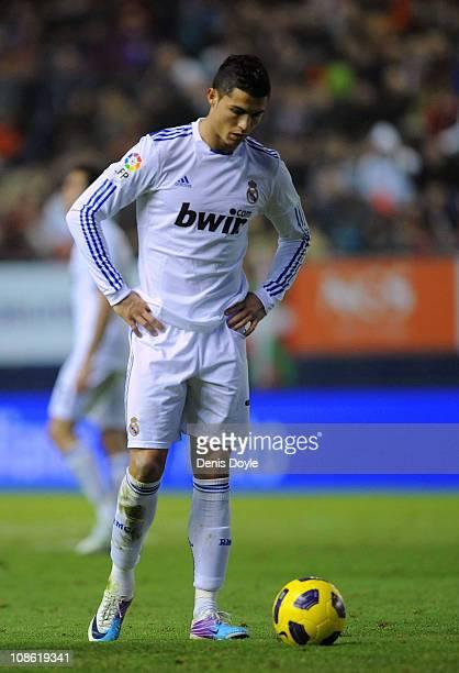Cristiano Ronaldo of Real Madrid prepares himself before taking a free kick during the La Liga match between CA Osasuna and Real Madrid at Estadio...