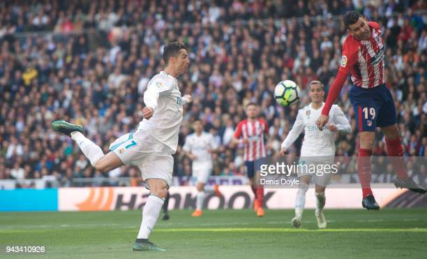 Cristiano Ronaldo of Real Madrid prepares to shoot past Lucas Hernandez of Atletico de Madrid to score his team's first goal past during the La Liga...