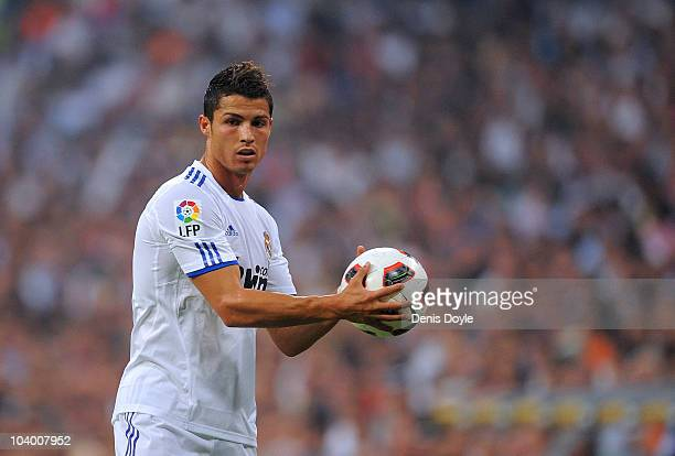 Cristiano Ronaldo of Real Madrid prepares to take a free kick during the La Liga match between Real Madrid and Osasuna at Estadio Santiago Bernabeu...