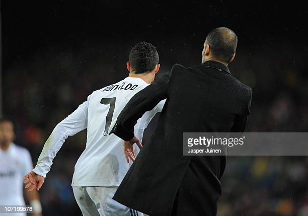 Cristiano Ronaldo of Real Madrid pushes head coach Josep Guardiola of Barcelona during the la liga match between Barcelona and Real Madrid at the...