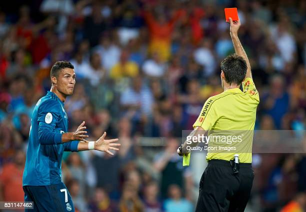Cristiano Ronaldo of Real Madrid reacts after a red card during the Supercopa de Espana Supercopa Final 1st Leg match between FC Barcelona and Real...