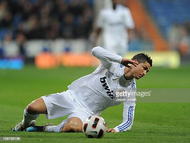 Cristiano Ronaldo of Real Madrid reacts after being fouled by Manu Torres of Malaga during the la Liga match between Real Madrid and Malaga at...