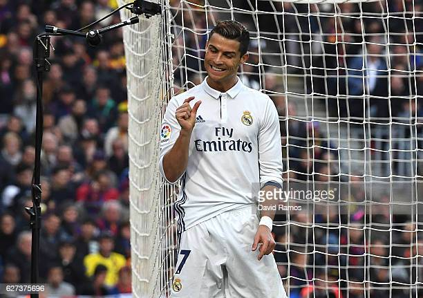 Cristiano Ronaldo of Real Madrid reacts after missing a chance during the La Liga match between FC Barcelona and Real Madrid CF at Camp Nou on...