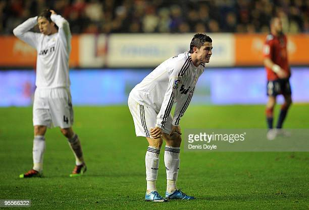 Cristiano Ronaldo of Real Madrid reacts after missing a free kick at goal during the La Liga match between CA Osasuna and Real Madrid at the Reyno de...
