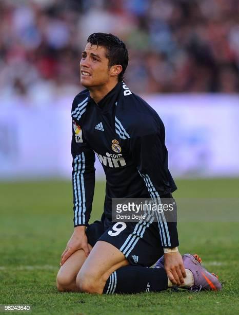 Cristiano Ronaldo of Real Madrid reacts after taking a knock during the La Liga match between Racing Santander and Real Madrid at El Sardinero...