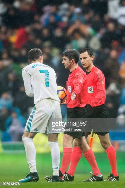 Cristiano Ronaldo of Real Madrid reacts and speaks to the referee Alberto Undiano Mallenco during the La Liga 201718 match between Real Madrid and...