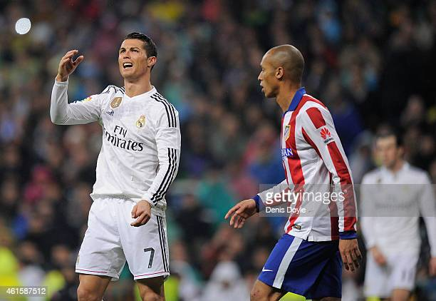 Cristiano Ronaldo of Real Madrid reacts beside Joao Miranda of Club Atletico de Madrid during the Copa del Rey Round of 16 Second leg match between...