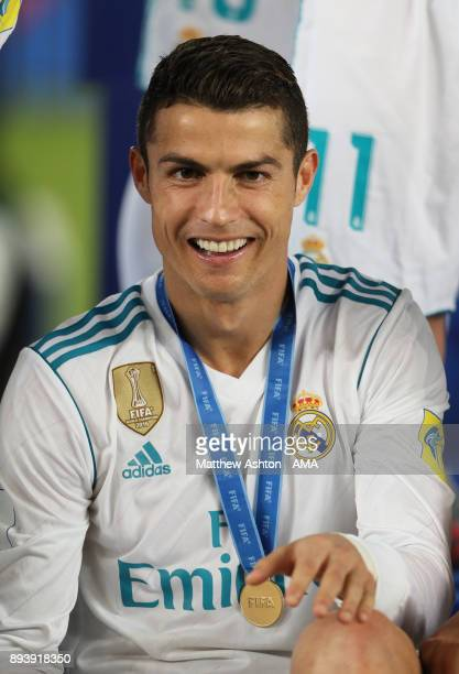 Cristiano Ronaldo of Real Madrid reacts with his winners medal at the end of the FIFA Club World Cup UAE 2017 final match between Gremio and Real...