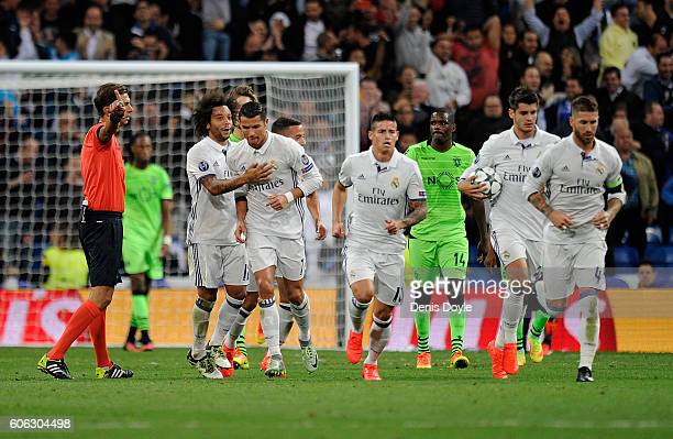 Cristiano Ronaldo of Real Madrid reacts with Marcelo after scoring Real's opening goal during the UEFA Champions League Group F match between Real...