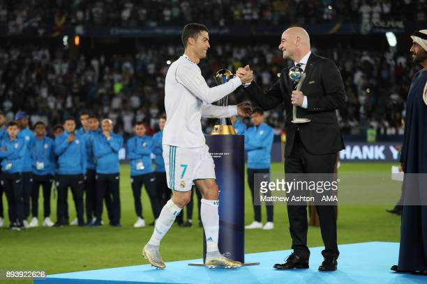 Cristiano Ronaldo of Real Madrid receives the adidas Golden Ball trophy from FIFA President Gianni Infantino at the end of the FIFA Club World Cup...