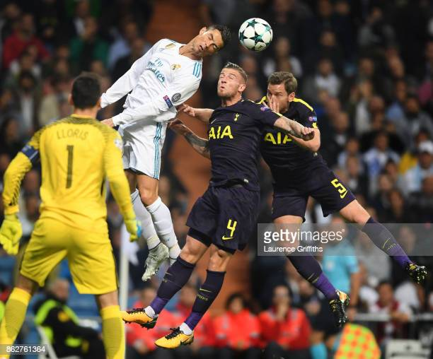 Cristiano Ronaldo of Real Madrid rises for the ball with Toby Alderweireld and Eric Dier of Tottenham Hotspur during the UEFA Champions League group...