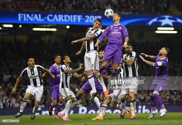 Cristiano Ronaldo of Real Madrid rises to meet a corner during the UEFA Champions League Final between Juventus and Real Madrid at National Stadium...