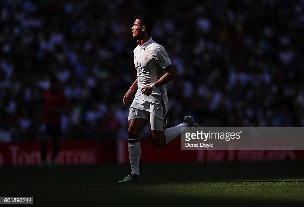 Cristiano Ronaldo of Real Madrid runs during the La Liga match between Real Madrid CF and CA Osasuna at Estadio Santiago Bernabeu on September 10...