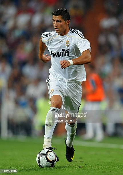 Cristiano Ronaldo of Real Madrid runs with the ball during the La Liga match between Real Madrid and Deportivo La Coruna at the Estadio Santiago...