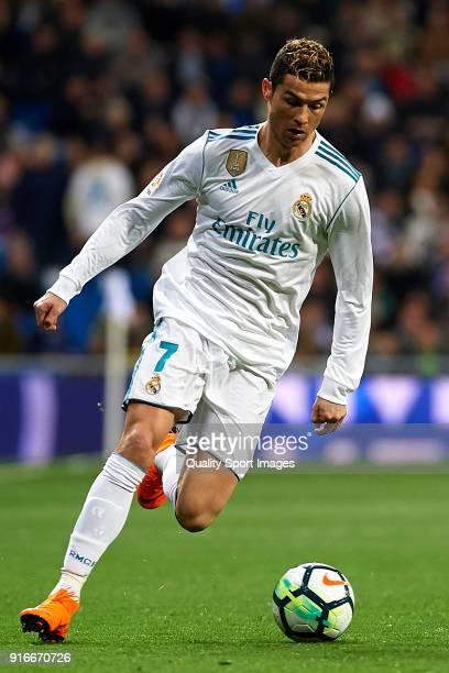 Cristiano Ronaldo of Real Madrid runs with the ball during the La Liga match between Real Madrid and Real Sociedad at Estadio Santiago Bernabeu on...