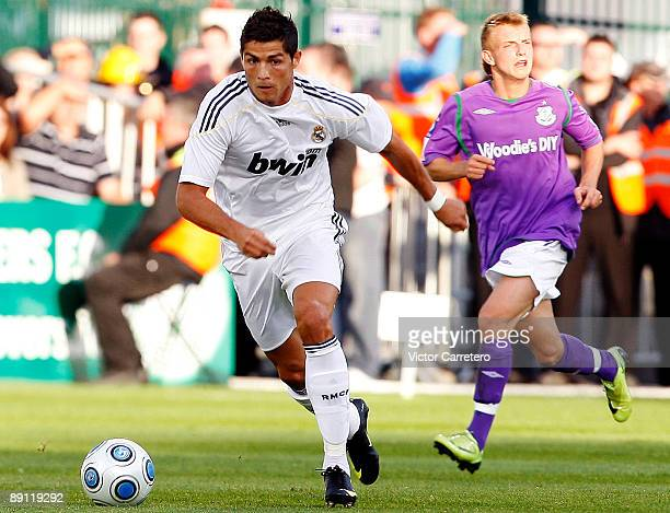 Cristiano Ronaldo of Real Madrid runs with the ball during the friendly match between Shamrock Rovers and Real Madrid on July 20 2009 in Dublin...