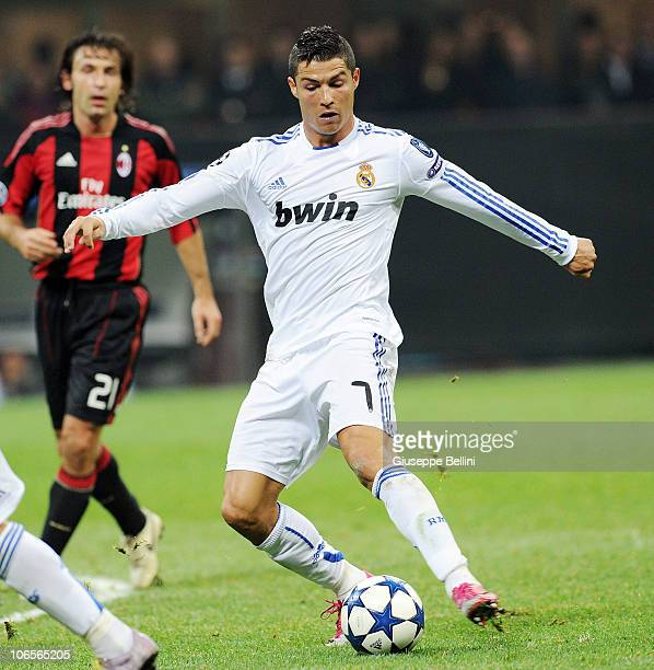 Cristiano Ronaldo of Real Madrid runs with the ball during the Uefa Champions League group G match between Milan and Real Madrid at Stadio Giuseppe...