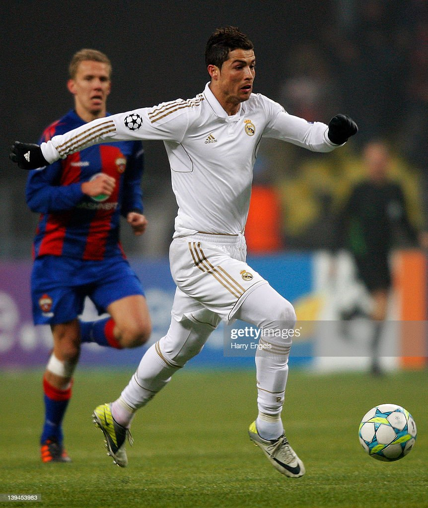 Uefa Champions League Round Of: Cristiano Ronaldo Of Real Madrid Runs With The Ball During