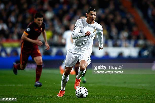 Cristiano Ronaldo of Real Madrid runs with the ball during the UEFA Champions League Round of 16 Second Leg match between Real Madrid and Roma at...