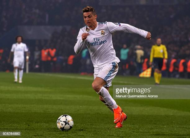 Cristiano Ronaldo of Real Madrid runs with the ball during the UEFA Champions League Round of 16 Second Leg match between Paris SaintGermain and Real...