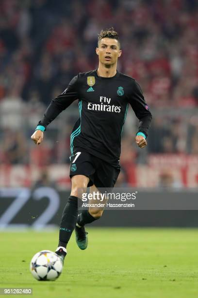 Cristiano Ronaldo of Real Madrid runs with the ball during the UEFA Champions League Semi Final First Leg match between Bayern Muenchen and Real...
