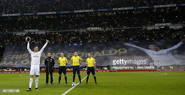 Cristiano Ronaldo of Real Madrid salutes with his FIFA Ballon d'Or before the Copa del Rey round of 16 second leg match between Real Madrid CF and...