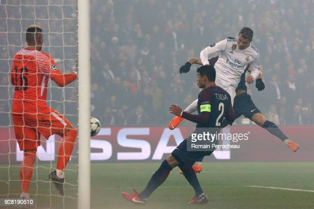 Cristiano Ronaldo of Real Madrid scores a goal during the UEFA Champions League Round of 16 Second Leg match between Paris SaintGermain and Real...