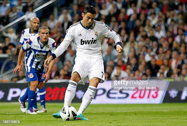 Cristiano Ronaldo of Real Madrid scores from penalty kick the opening goal during the La Liga match between Real Madrid and Deportivo La Coruna at...
