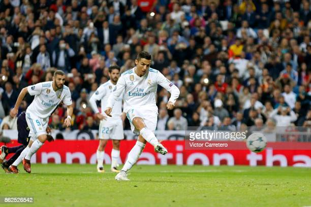 Cristiano Ronaldo of Real Madrid scores from penalty spot his team's first goal during the UEFA Champions League group H match between Real Madrid CF...