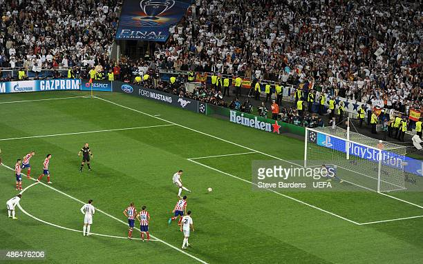 Cristiano Ronaldo of Real Madrid scores from the penalty spot during the UEFA Champions League Final between Real Madrid CF and Club Atletico de...